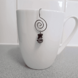 garnet intention tea infuser Twisted by mish.png
